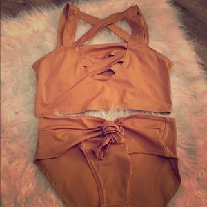Bronze colored bathing suit